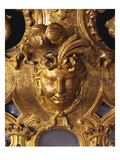 A Regence Giltwood Mirror  Detail  the Plate Surmounted by an Indian Mask with Ribbon-Tied Plumed…