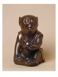A Finely Modelled Gold Lacquered Oikimono of a Macaque Monkey
