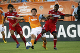 Houston August 21 - Baggio Husidic  Brian Ching and Dasan Robinson