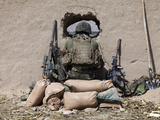 A US Marine Sniper Observes His Sector at a Patrol Base Near Sangin  Afghanistan