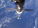 Space Shuttle Discovery Approaches the International Space Station