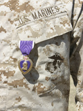 The Purple Heart Award Hangs over the Heart of a US Marine