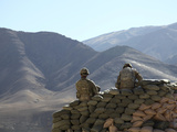 US Army Soldiers Run Communications Equipment from a Sandbag Bunker in Afghanistan