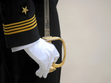 A US Naval Academy Midshipman Stands at Attention