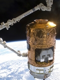 The Japanese H-II Transfer Vehicle in the Grasp of Canadarm2