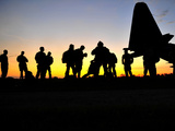Green Berets Prepare to Board a KC-130 Aircraft
