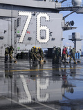 Sailors Scrub the Flight Deck Aboard the Aircraft Carrier USS Ronald Reagan