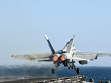 An F/A-18F Super Hornet Launches from the Flight Deck of Aircraft Carrier USS Nimitz