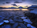 Ice Flakes Drifting Against the Sunset in Tjeldsundet Strait  Troms County  Norway