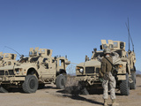 US Marines Guides a Mine Resistant Ambush Protected All-Terrain Vehicle
