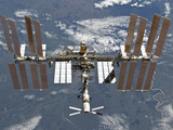 International Space Station Backgropped by a Blue and White Earth