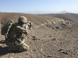 US Army Soldier Provides Security for Infantry Patrolling Through Dandarh Village  Afghanistan