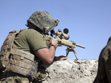 A US Marine Looks Through the Scope of an M40A1 Sniper Rifle