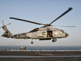 A US Navy SH-60F Seahawk Hovers Above the Flight Deck of USS Eisenhower