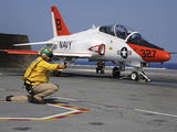 A Shooter Signlas the Launch of a T-45A Goshawk Trainer Aircraft