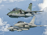 A Brazilian Air Force Embraer A-1B  French Air Force Rafale  and US Air Force F-16C Fighting Falcon