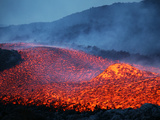 Boulder Rolling in Lava Flow at Dusk During Eruption of Mount Etna Volcano  Sicily  Italy