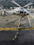 Marines Prepare to Board an MH-60S Sea Hawk Helicopter Aboard USS Peleliu