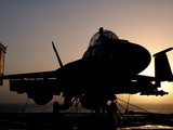 Silhouette of a US Navy F/A-18E Super Hornet on the Flight Deck of USS Nimitz