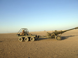 A 105MM Light Gun Being Towed by an All-Terrain Vehicle