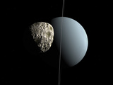 Artist&#39;s Concept of How Uranus and its Tiny Moon Puck