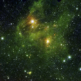 Two Extremely Bright Stars Illuminate a Greenish Mist in Deep Space