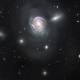 Spiral Galaxy NGC 4911 Located Deep Within the Coma Cluster of Galaxies