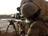 US Marine Looks Through the Scope of His M16A4 Rifle for Enemy Forces