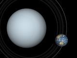 Artist&#39;s Concept of Uranus and Earth to Scale