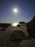 A Full Moon Skyscape over a Small Beach Called Portinho Da Arrabida  Portugal