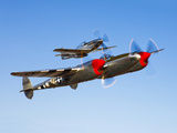A P-38 Lightning and P-51D Mustang in Flight