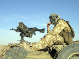 A Gunner Sits Atop a British Army WMIK Land Rover