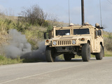 A Mock Improvised Explosive Device Explodes in the Window of a Humvee