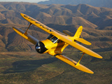 A Beechcraft D-17 Staggerwing in Flight