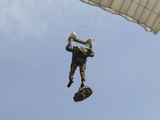 A Member of the Pathfinder Platoon Prepares to Land from a Parachute Jump