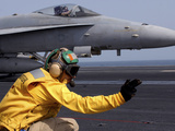 A Shooter Launches an F/A-18E Super Hornet from USS Ronald Reagan