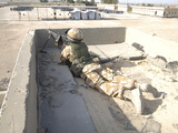 A British Soldier Provides Security from a Rooftop in Basra  Iraq