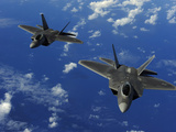 US Air Force F-22 Raptors in Flight Near Guam