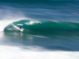 A Surfer Braves the Shallow Waves at Uluwatu