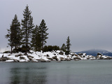 Scenic Snow Covered Rocks and Evergreens on the Shore of Lake Tahoe