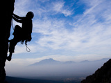 A Climber Ascends an Overhang at Dusk 500 Feet Off the Ground