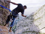 A Climber Leans Out to Take a Photo from 500 Feet Up