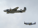 A B-25 Mitchell and a P-51 Mustang in Flight