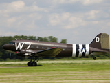 A Douglas Dc-3 in Military Paint Takes-Off from a Grass Airfield