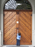 Young Boy Reaches for Door Handle at St Peter's Church