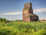 A Derelict Grain Elevator Weathers Away on the Canadian Prairie