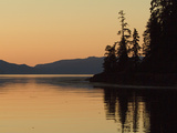 Calm Bay at Sunset Surrounded by Boreal Forest  Southeast Alaska