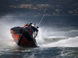 A Canadian Coast Guard Search and Rescue Zodiac Boat in Action