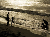 A Family Plays on Grande Riviere Beach at Sunset