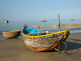 Wooden Fishing Boats and a Basket Boat from the Fleet in Mui Ne Vietnam